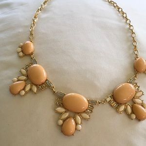 Coral and white beaded necklace with rhinestones.